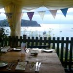 Rudds Lulworth Wedding Venue - table setting with stunning view